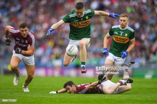 Dublin Ireland 15 July 2018 Jason Foley of Kerry jumps over Ian Burke of Galway as Damien Comer of Galway and Peter Crowley of Kerry look on during...