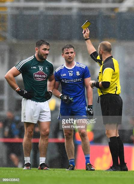 Dublin Ireland 15 July 2018 Referee Anthony Nolan shows both Fergal Conway of Kildare and Dessie Mone of Monaghan a yellow card during the GAA...