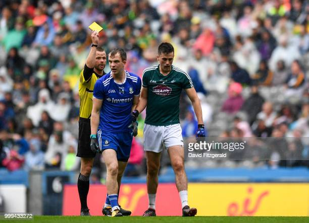 Dublin Ireland 15 July 2018 Referee Anthony Nolan shows both Jack McCarron of Monaghan and Tommy Moolick of Kildare a yellow card during the GAA...