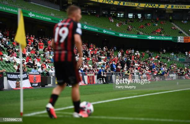 Dublin , Ireland - 15 July 2021; Supporters look on as Tyreke Wilson of Bohemians prepares to take a corner during the UEFA Europa Conference League...