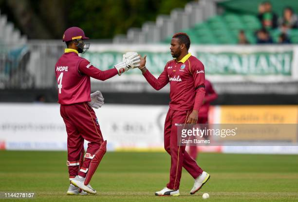 Dublin , Ireland - 15 May 2019; Fabian Allen of West Indies, right, celebrates with Shai Hope after taking a wicket during the One-Day International...
