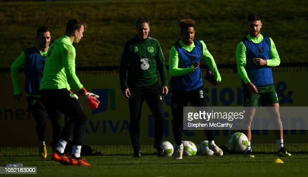 Dublin Ireland 15 October 2018 Republic of Ireland players from left Alan Browne Sean McDermott assistant coach Steve Guppy Callum Robinson and Scott...
