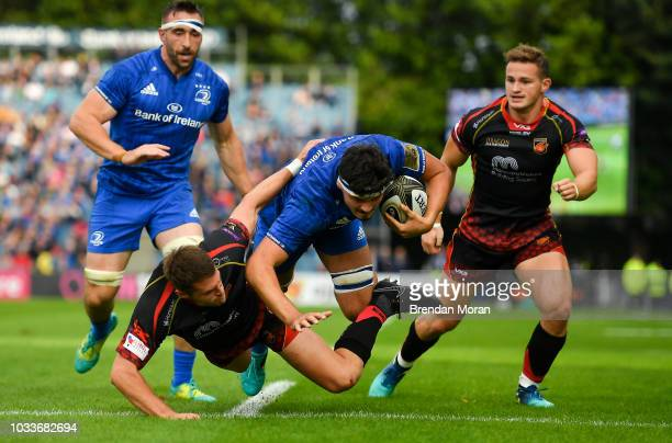 Dublin Ireland 15 September 2018 Max Deegan of Leinster is tackled by Josh Lewis of Dragons during the Guinness PRO14 Round 3 match between Leinster...