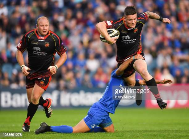 Dublin Ireland 15 September 2018 Tavis Knoyle of Dragons is tackled by Jamison GibsonPark of Leinster during the Guinness PRO14 Round 3 match between...
