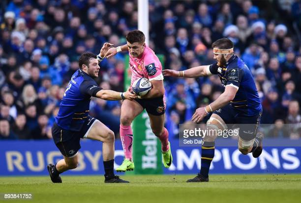 Dublin Ireland 16 December 2017 Henry Slade of Exeter Chiefs is tackled by Robbie Henshaw left and Sean O'Brien of Leinster during the European Rugby...