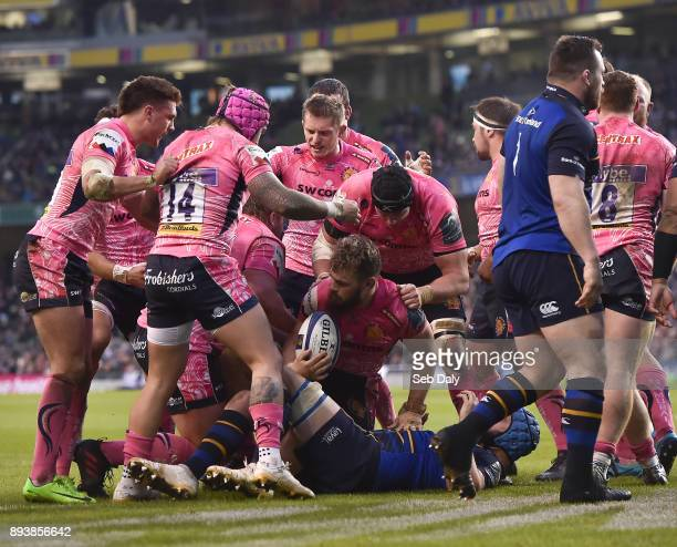Dublin Ireland 16 December 2017 Luke CowanDickie of Exeter Chiefs centre is congratulated by teammates after scoring his side's second try during the...