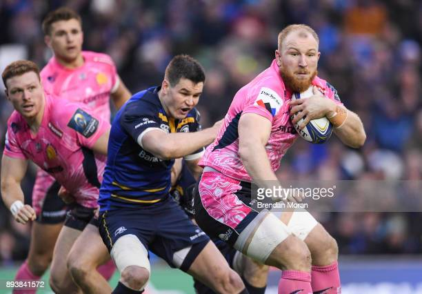 Dublin Ireland 16 December 2017 Matt Kvesic of Exeter Chiefs is tackled by Jonathan Sexton of Leinster before Sexton leaves the pitch with an injury...