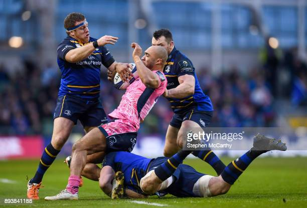 Dublin Ireland 16 December 2017 Olly Woodburn of Exeter Chiefs is tackled by Leinster players from left Sean Cronin Jack Conan and Cian Healy during...