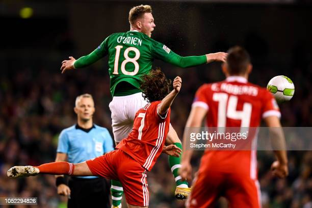 Dublin Ireland 16 October 2018 Aiden O'Brien of Republic of Ireland in action against Joe Allen of Wales during the UEFA Nations League B group four...