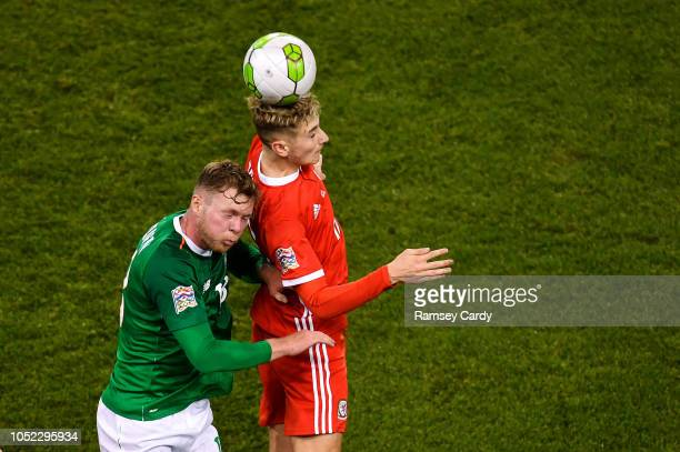 Dublin Ireland 16 October 2018 Aiden O'Brien of Republic of Ireland in action against David Brooks of Wales during the UEFA Nations League B group...
