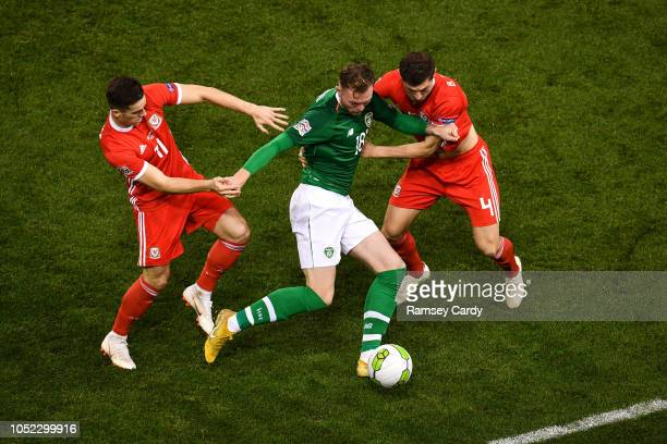 Dublin Ireland 16 October 2018 Aiden O'Brien of Republic of Ireland in action against Tom Lawrence left and Ben Davies of Wales during the UEFA...