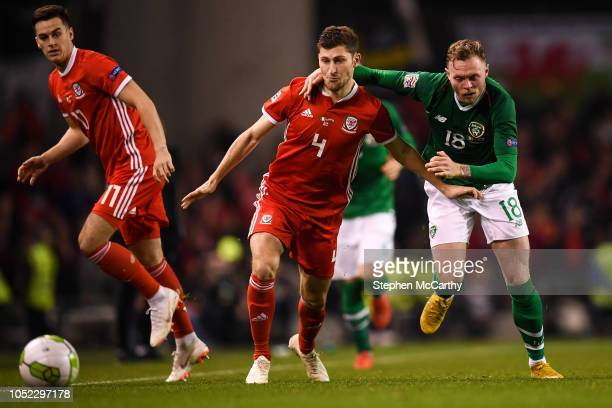 Dublin Ireland 16 October 2018 Ben Davies of Wales in action against Aiden O'Brien of Republic of Ireland during the UEFA Nations League B group four...