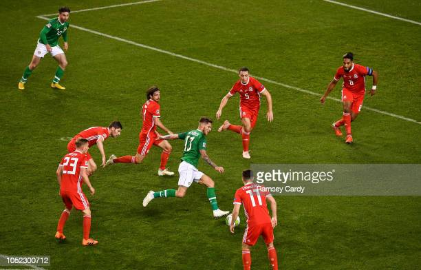 Dublin Ireland 16 October 2018 Jeff Hendrick of Republic of Ireland shoots at goal during the UEFA Nations League B group four match between Republic...