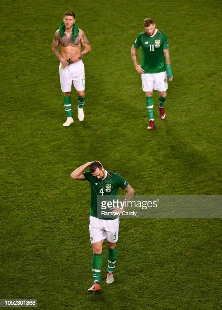Dublin Ireland 16 October 2018 Republic of Ireland players Jeff Hendrick left Shane Duffy centre and James McClean walk off the pitch following their...