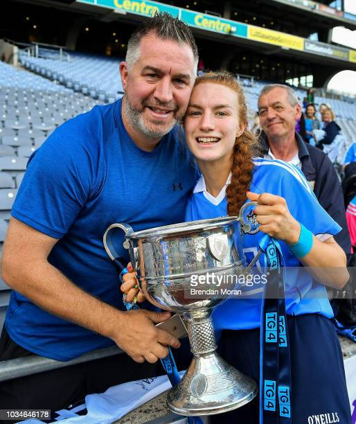 Dublin Ireland 16 September 2018 Lauren Magee of Dublin celebrates with her father Johnny Magee and the Brendan Martin Cup after the TG4 AllIreland...