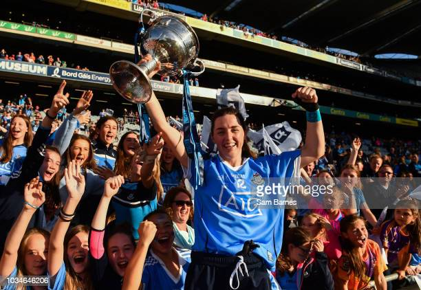 Dublin Ireland 16 September 2018 Lyndsey Davey of Dublin celebrates with supporters and the Brendan Martin Cup following the TG4 AllIreland Ladies...