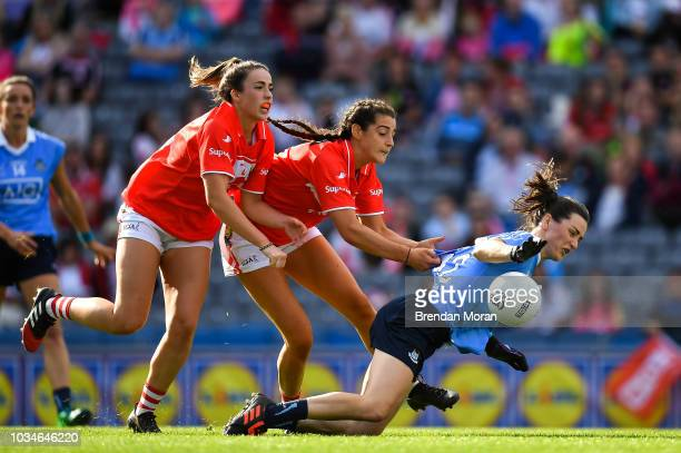 Dublin Ireland 16 September 2018 Lyndsey Davey of Dublin is fouled by Eimear Meaney and Shauna Kelly of Cork resulting in a penalty during the TG4...