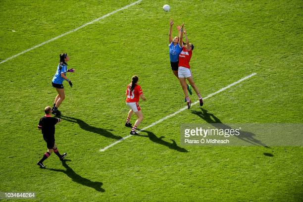 Dublin Ireland 16 September 2018 Niamh McEvoy of Dublin contests the throwin at the start of the first half with Hannah Looney of Cork during the TG4...