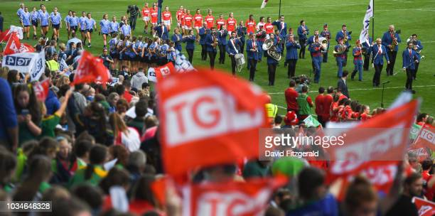 Dublin Ireland 16 September 2018 The teams parade behind the band prior to the TG4 AllIreland Ladies Football Senior Championship Final match between...