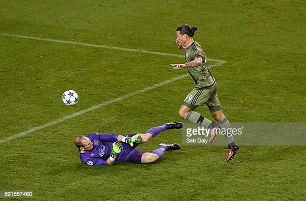 Dublin Ireland 17 August 2016 Aleksandar Prijovi of Leiga Warsaw scores his team's second goal past Gary Rogers of Dundalk FC during the UEFA...