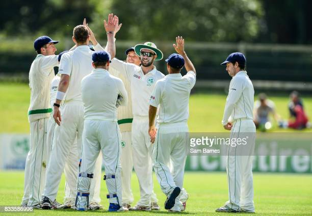 Dublin Ireland 17 August 2017 Andrew Balbirnie of Ireland centre is congratulated by team mates after catching out Max O'Dowd of Netherlands during...