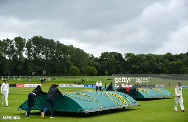 Dublin Ireland 17 August 2017 Players leave the field and rain covers are put on the crease as play is halted due to rain during the ICC...