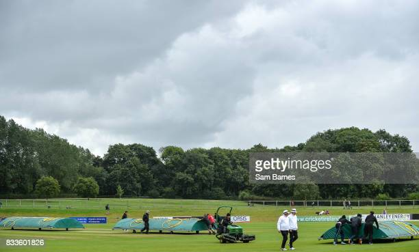 Dublin , Ireland - 17 August 2017; The Umpires leave the field and rain covers are put on the crease as play is halted due to rain during the ICC...