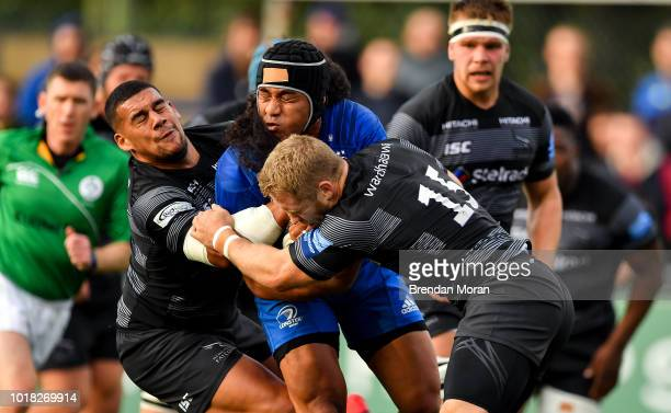 Dublin , Ireland - 17 August 2018; Joe Tomane of Leinster is tackled by Josh Matavesi, left, and Alex Tait of Newcastle Falcons during the Bank of...