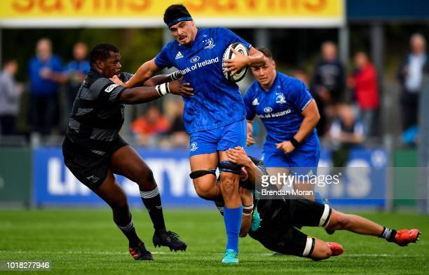 Dublin Ireland 17 August 2018 Max Deegan of Leinster is tackled by Sami Mavinga left and Connor Collett of Newcastle Falcons during the Bank of...