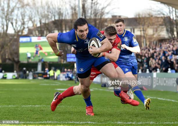 Dublin Ireland 17 February 2018 James Lowe of Leinster goes over to score his side's first try despite the tackle of Corey Baldwin of Scarlets during...