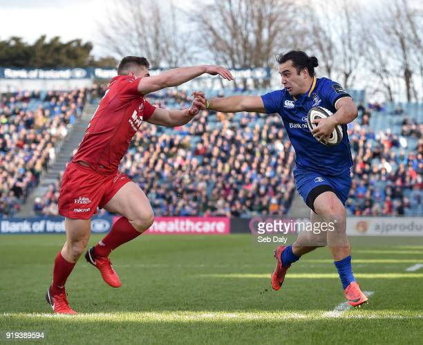 Dublin Ireland 17 February 2018 James Lowe of Leinster holds of the tackle of Corey Baldwin of Scarlets on his way to scoring his side's first try...