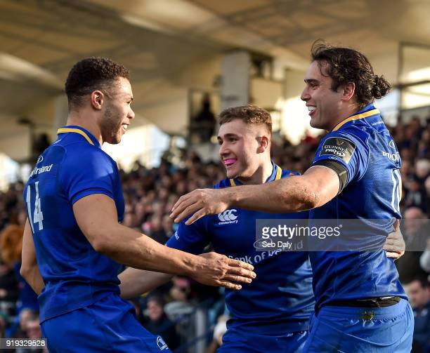 Dublin Ireland 17 February 2018 James Lowe of Leinster right is congratulated by teammates Adam Byrne left and Jordan Larmour centre after scoring...