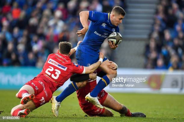 Dublin Ireland 17 February 2018 Jordan Larmour of Leinster is tackled by Tom Williams left and Paul Asquith of Scarlets during the Guinness PRO14...