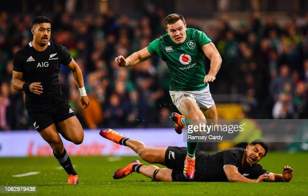 Dublin Ireland 17 November 2018 Jacob Stockdale of Ireland in action against Anton LienertBrown of New Zealand during the Guinness Series...