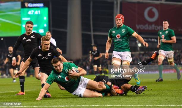 Dublin Ireland 17 November 2018 Jacob Stockdale of Ireland is tackled by Aaron Smith of New Zealand on his way to scoring his side's first try during...