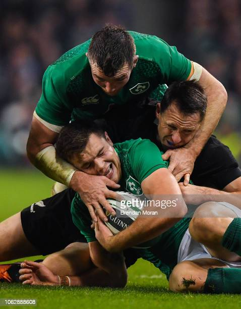 Dublin Ireland 17 November 2018 Jacob Stockdale of Ireland supported by teammate Peter OMahony is tackled by Ben Smith of New Zealand during the...