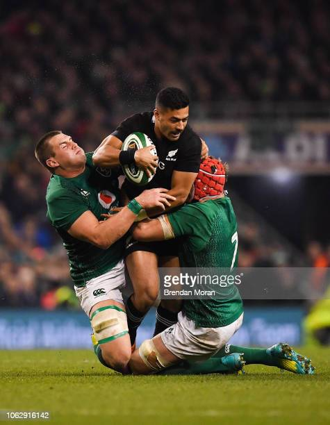 Dublin Ireland 17 November 2018 Richie Mo'unga of New Zealand is tackled by CJ Stander left and Josh van der Flier of Ireland during the Guinness...