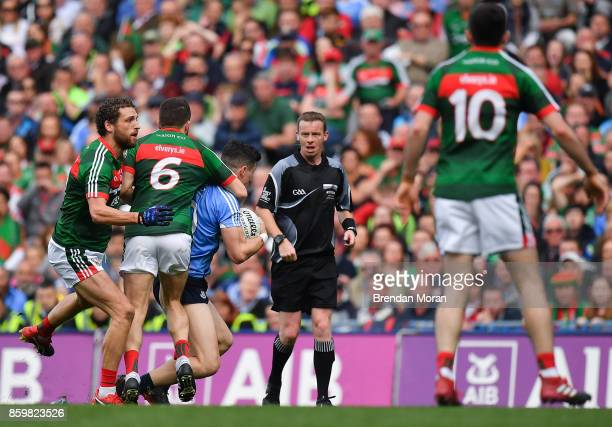 Dublin Ireland 17 September 2017 Diarmuid Connolly of Dublin is tackled by Chris Barrett of Mayo resulting in a last minute free kick which Dublin...