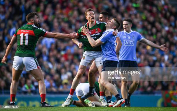 Dublin Ireland 17 September 2017 Donal Vaughan of Mayo tackles John Small of Dublin resulting in a red card for both players during the GAA Football...