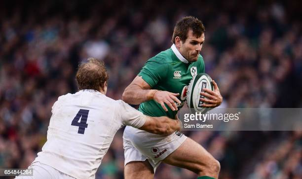 Dublin Ireland 18 March 2017 Jared Payne of Ireland is tackled by Joe Launchbury of England during the RBS Six Nations Rugby Championship match...