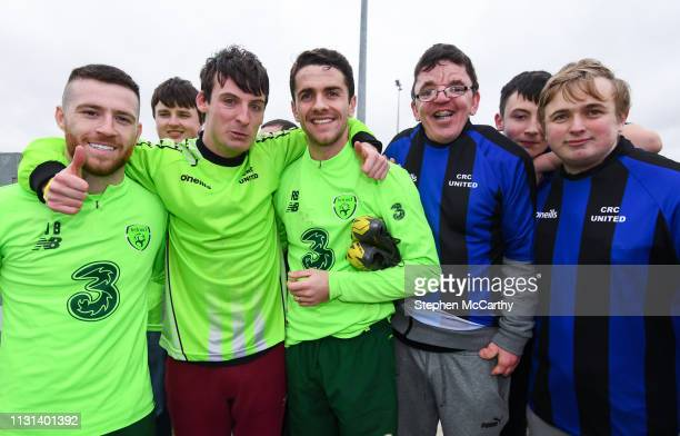 Dublin Ireland 18 March 2019 Jack Byrne left and Robbie Brady meet players from CRC United Clontarf following a Republic of Ireland training session...