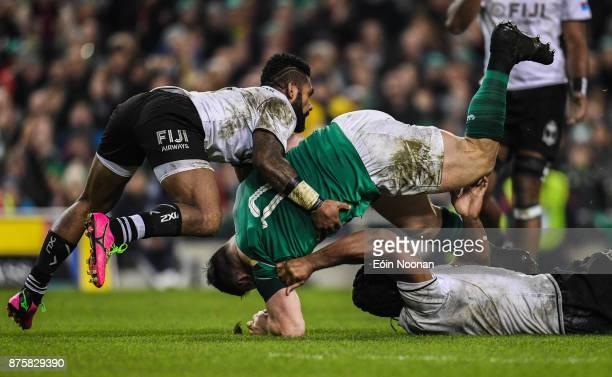 Dublin Ireland 18 November 2017 Cian Healy of Ireland is tackled by Ben Volavola left and Dominiko Waqaniburotu of Fiji during the Guinness Series...