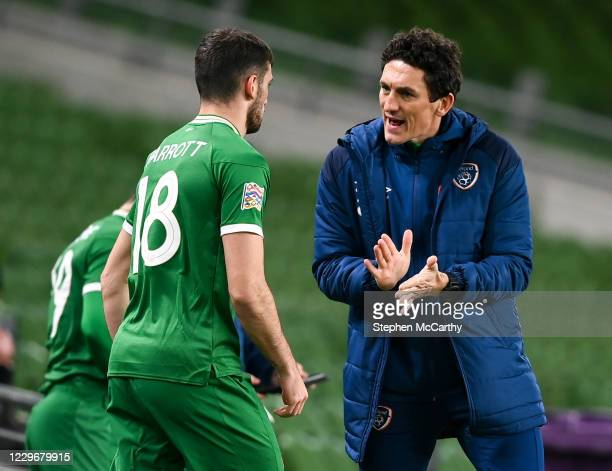 Dublin , Ireland - 18 November 2020; Republic of Ireland coach Keith Andrews speaks to Troy Parrott before coming on a second half substitute during...