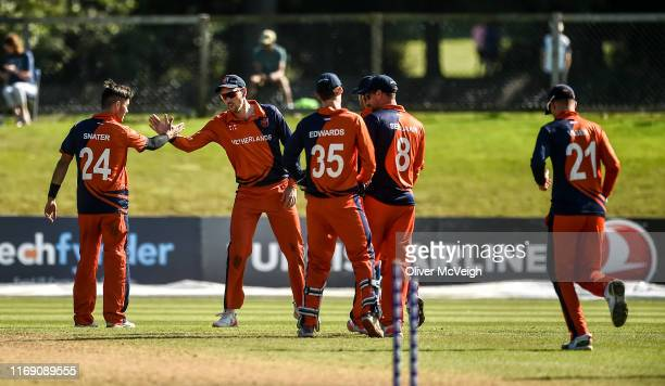 Dublin , Ireland - 18 September 2019; The Netherlands players celebrate after taking a wicket during the T20 International Tri Series match between...