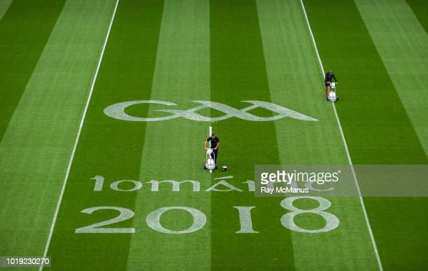 Dublin Ireland 19 August 2018 Colm Daly left and Ben Turner both members of the Croke Park groundstaff mark lines on the pitch in advance of the GAA...