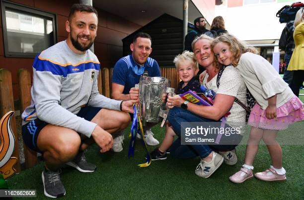 Dublin Ireland 19 August 2019 James Barry left and Seán OBrien of Tipperary second from left with Ed Mortimer aged 2 Claire Joyce Emily Mortimer aged...