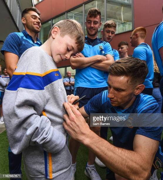 Dublin Ireland 19 August 2019 John ODwyer of Tipperary signs an autograph for Harry Tutty aged 9 from Gorey Co Wexford on a visit by the Tipperary...