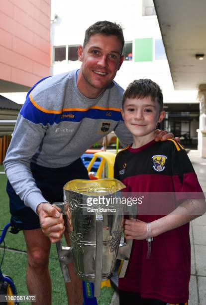 Dublin Ireland 19 August 2019 Séamus Callanan of Tipperary and Harry Tutty aged 9 from Gorey Co Wexford with the Liam MacCarthy Cup on a visit by the...