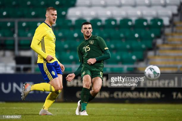 Dublin Ireland 19 November 2019 Troy Parrott of Republic of Ireland shoots to score his side's third goal despite the attention of Fleix Beijmo of...