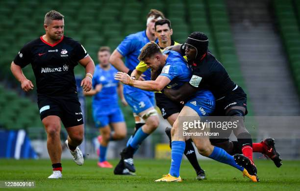 Dublin Ireland 19 September 2020 Garry Ringrose of Leinster is tackled by Maro Itoje of Saracens during the Heineken Champions Cup QuarterFinal match...